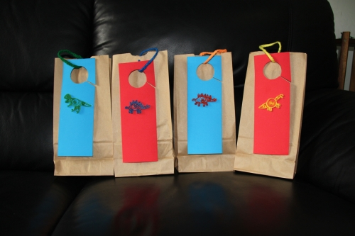 Paper quilled dinosaur party gift bags