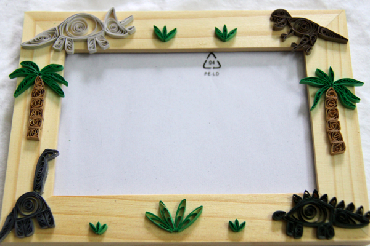 A paper quilled dinosaur frame